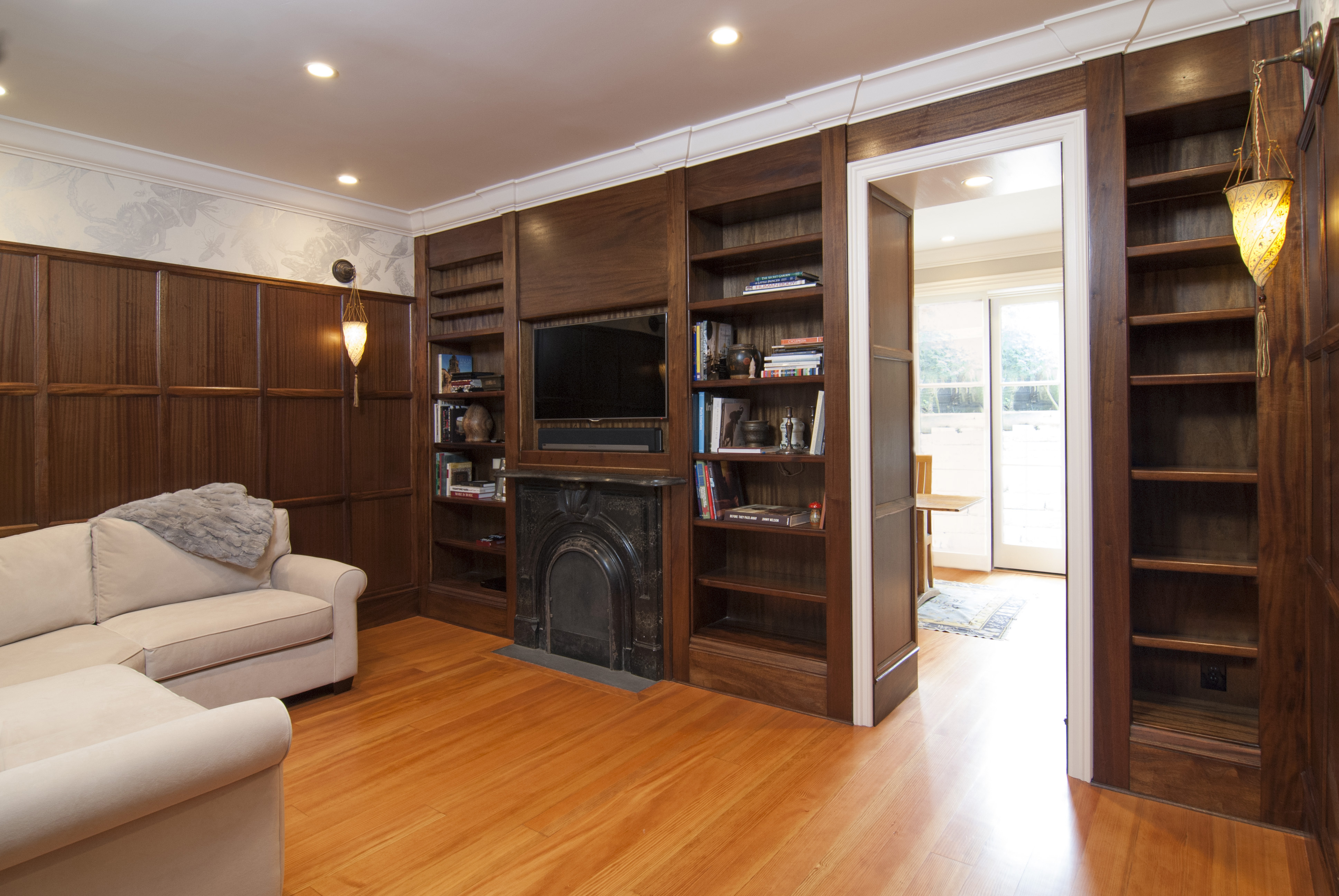 Beautiful Office Built-Ins with Open Shelves and a Marble Fire Place