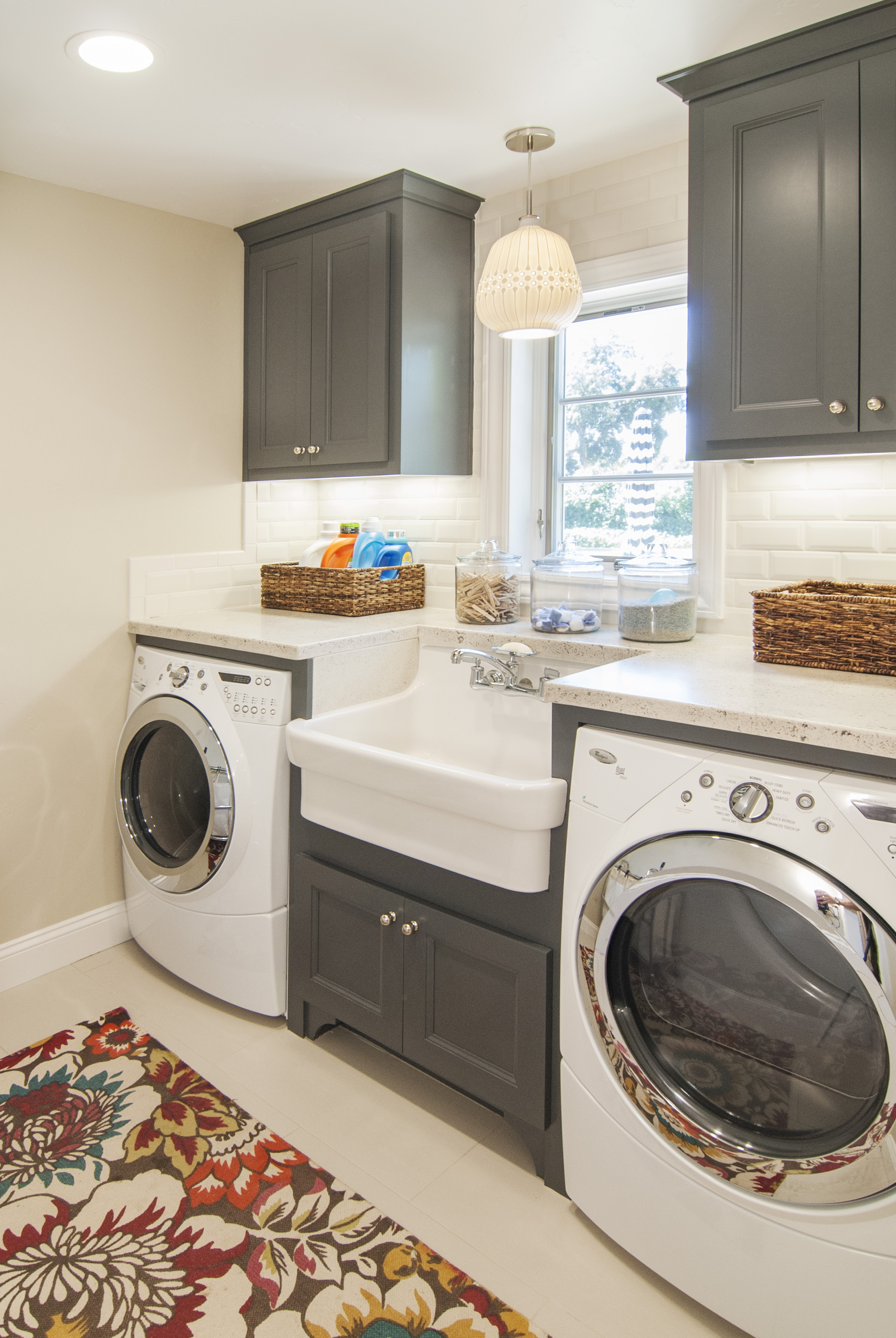 Beautiful Painted Laundry Room Built Ins With A White Farm House Sink And Whirpool