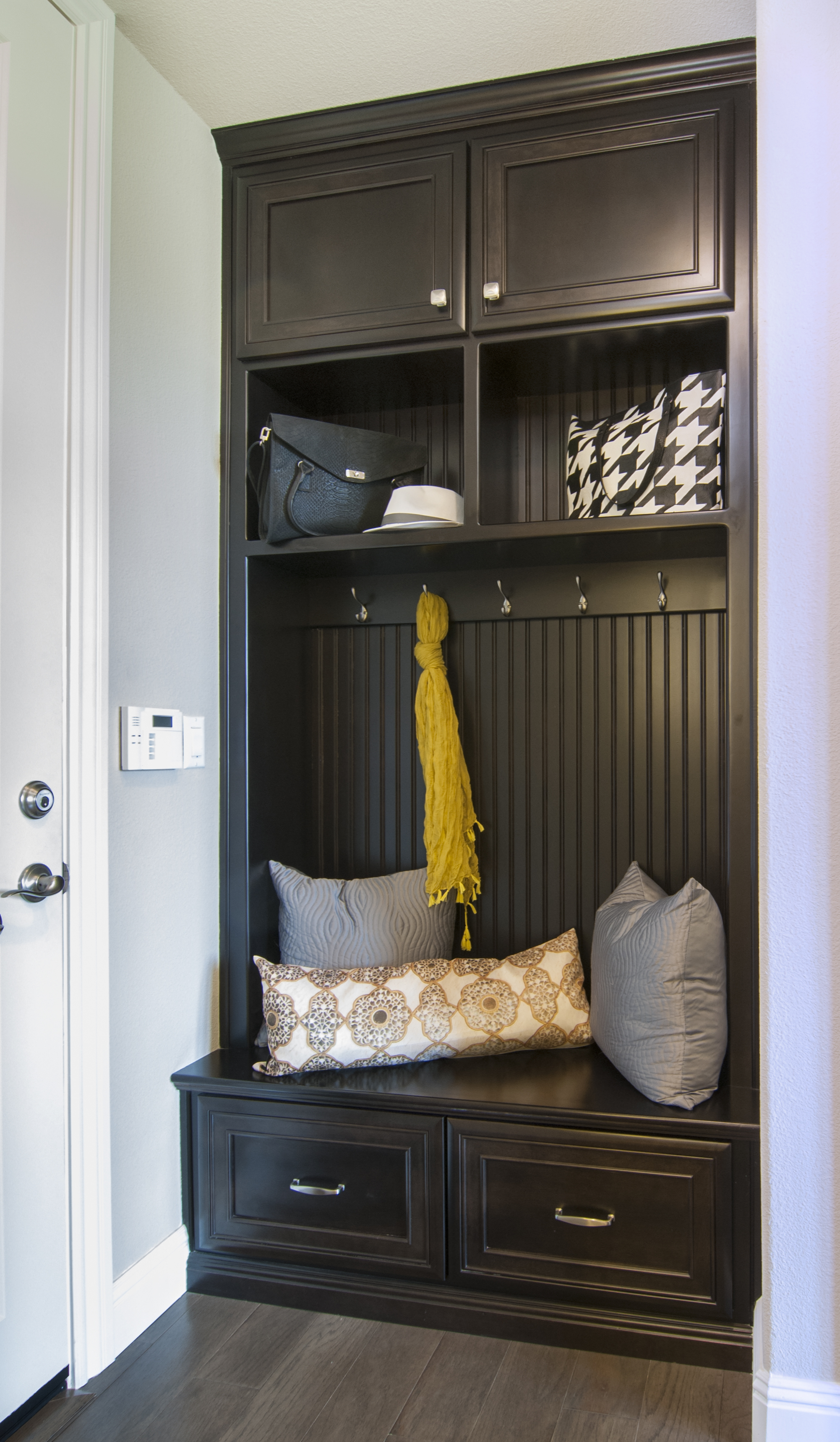 Beautiful Dark Espresso Stained Mud Room Built-In with Beadboard Backing, Open Shelves and Silver Hardware
