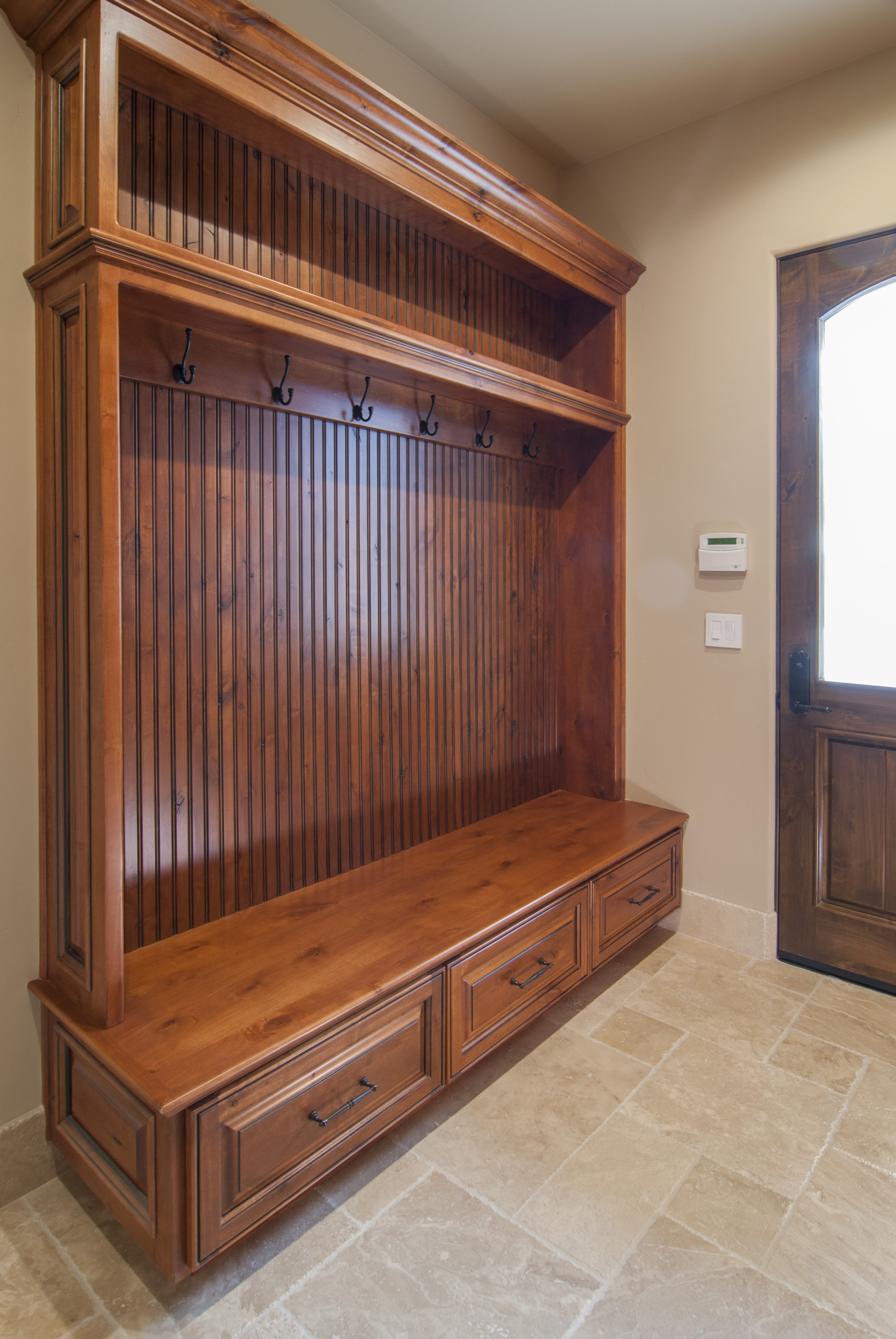 Traditional Mudroom Built in Knotty Alder with Beadboard Backing and Oil Rubbed Bronze Hardware