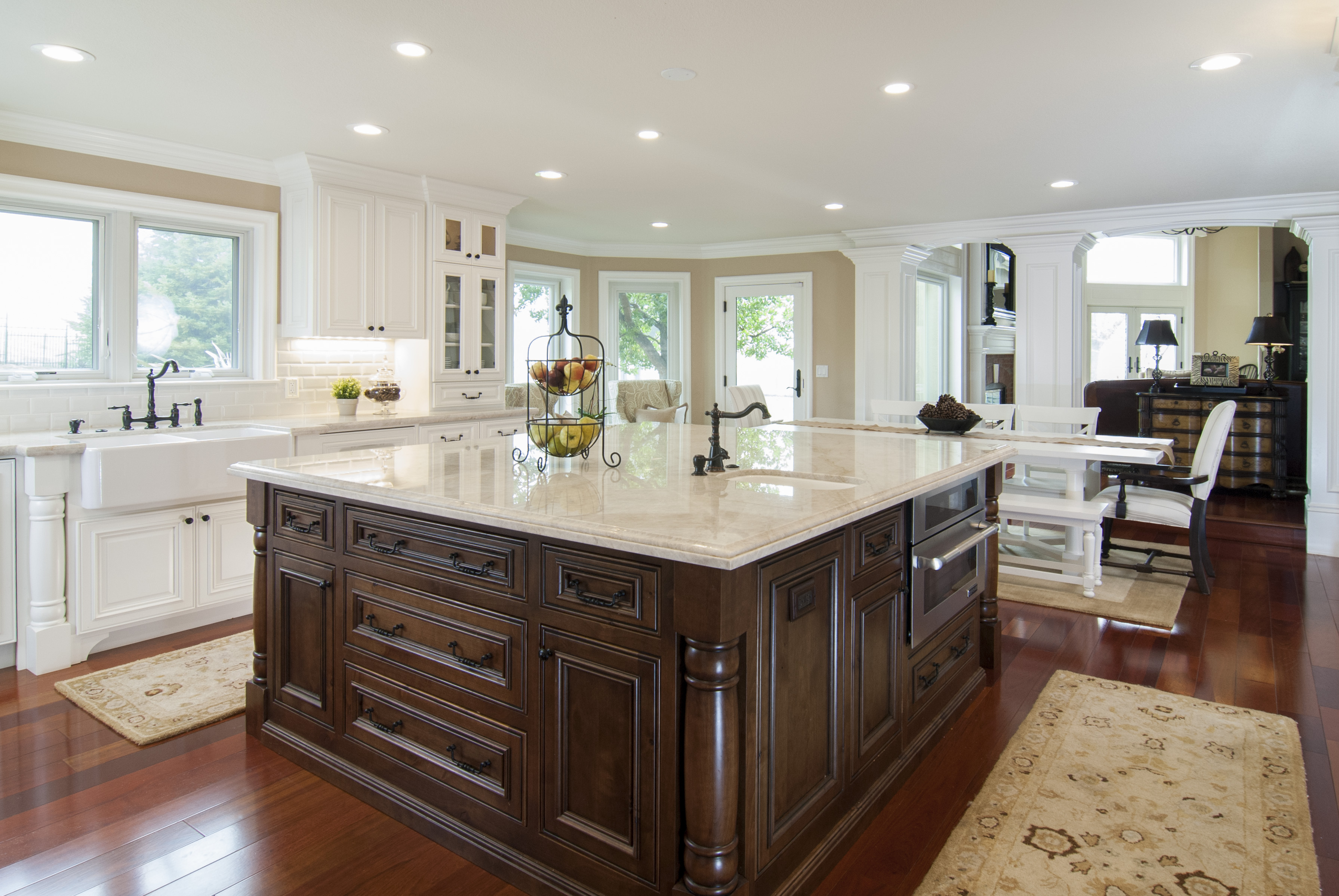 Traditional Stained And Painted Kitchen With Stainless Steel Appliances And  A Beautiful Farm House Sink