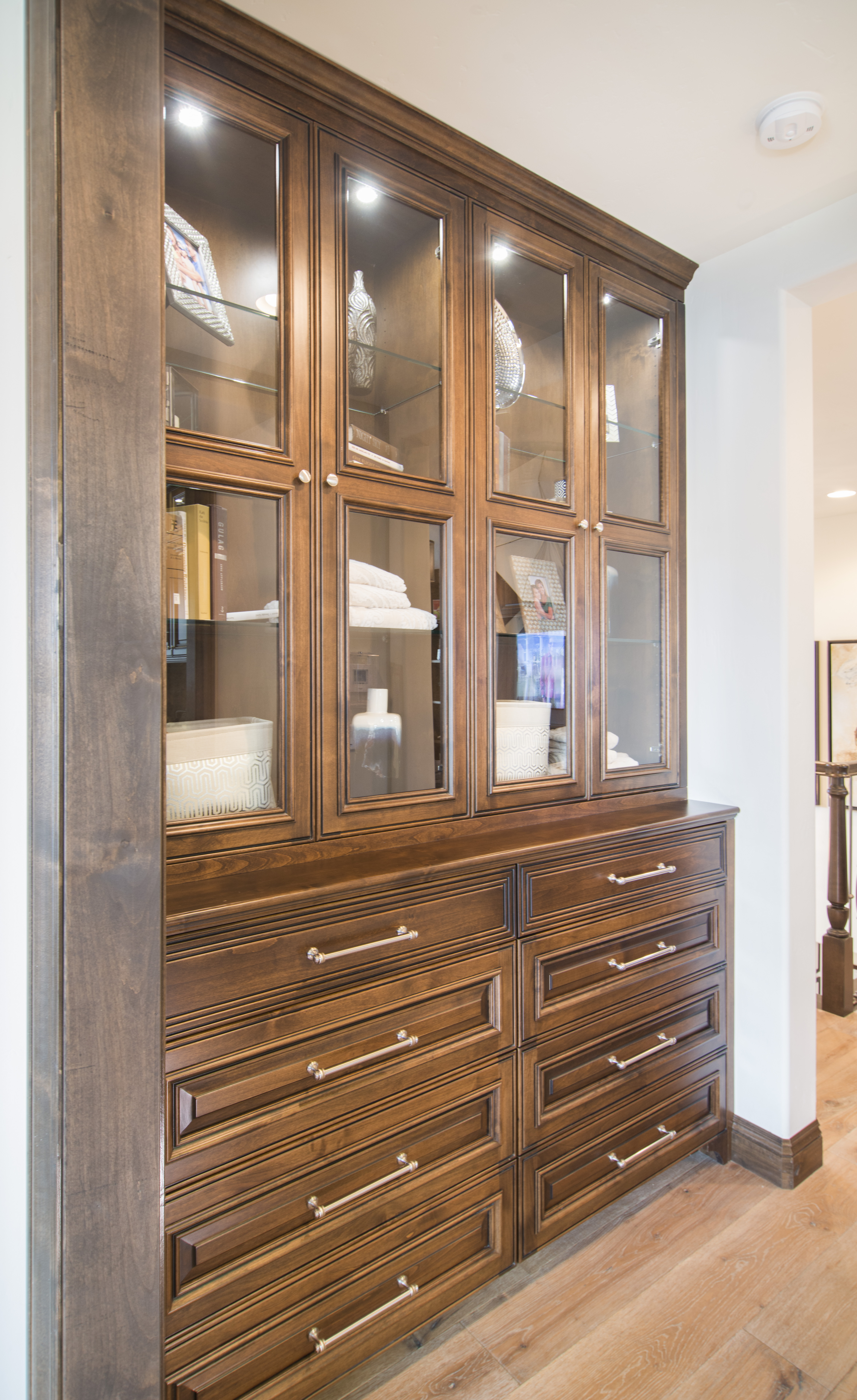 Beautiful Traditional Built-In with Glass Doors, Glass Shelves and Stainless Steel Knobs - Pulls