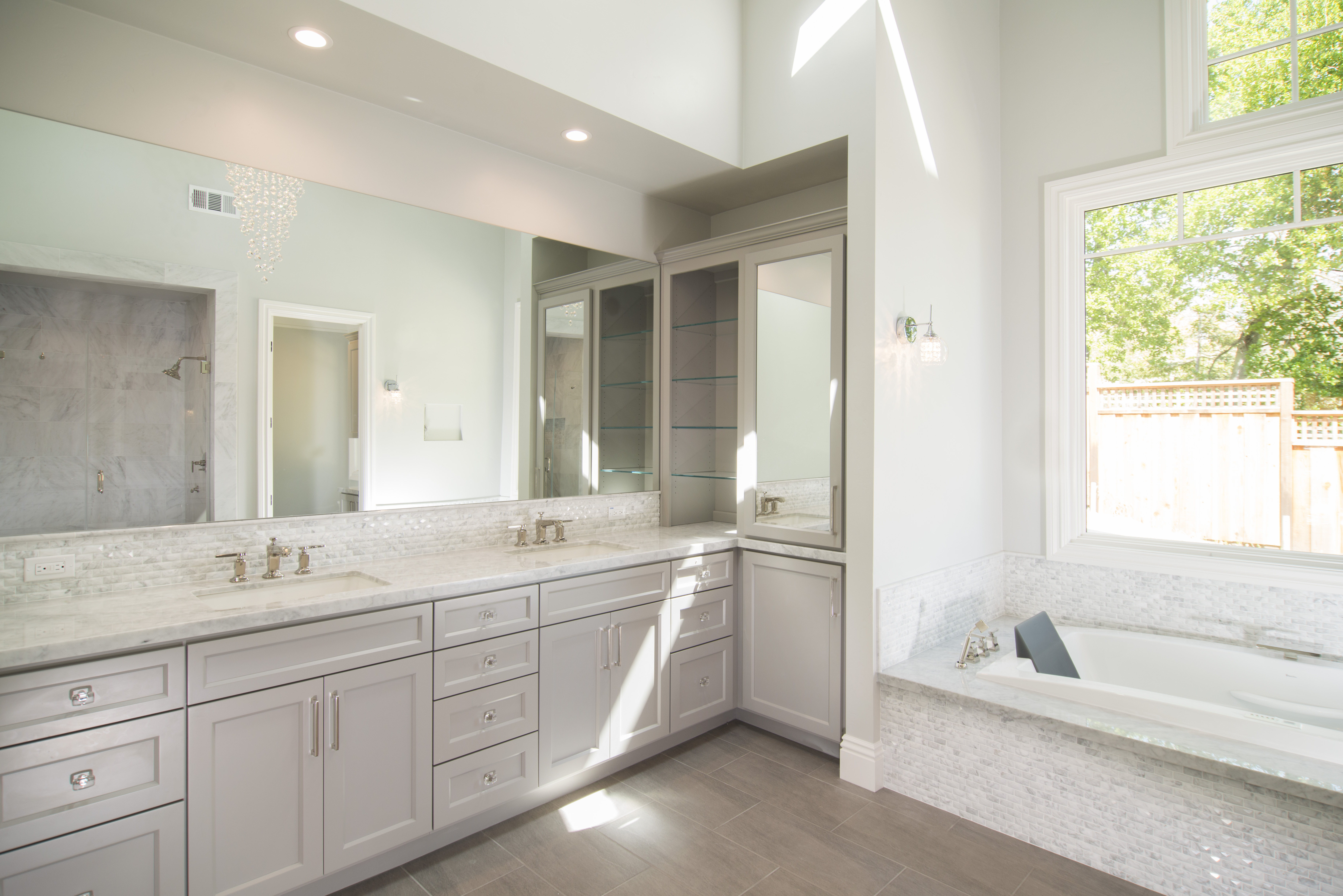 Clean Transitional Master Bathroom with Built-In Glass Shelves