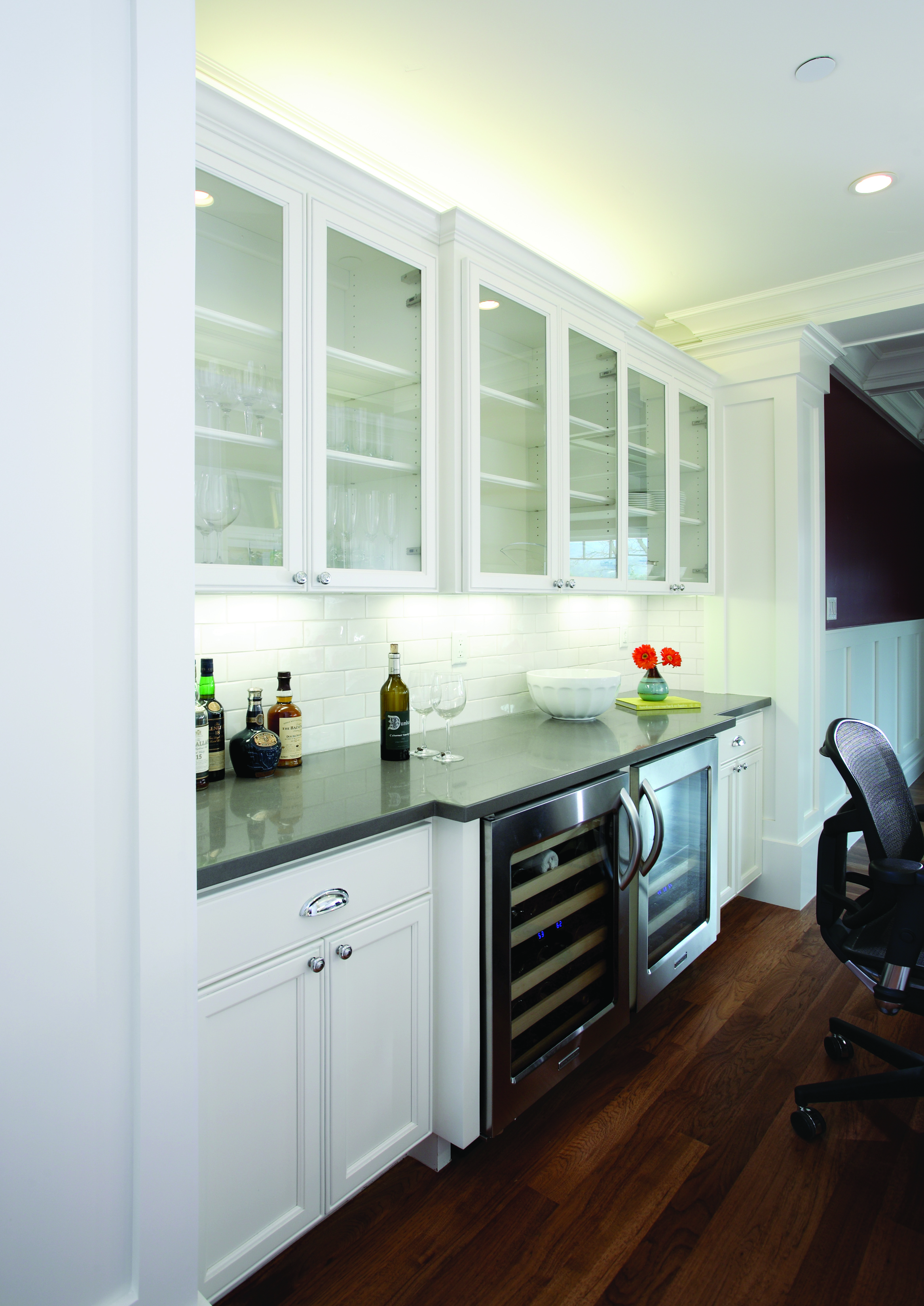 Transitional White Wine Bar with Beautiful Glass Doors, Two Built-In Kitchen Aid Wine Cellars and a Charcoal Grey Counter Top