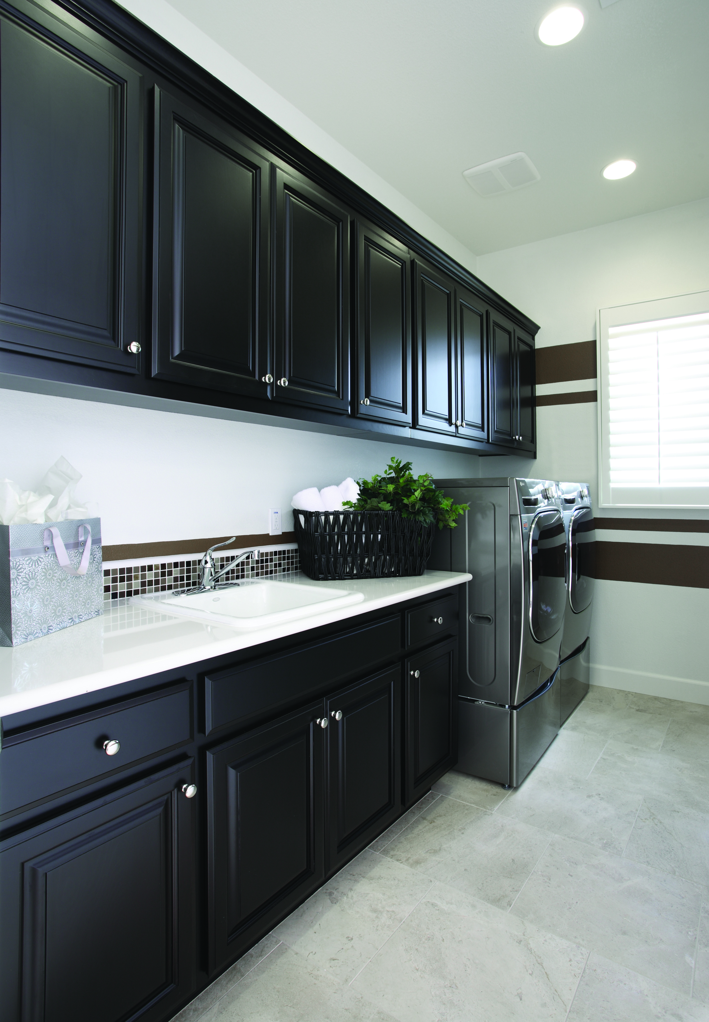 Beautiful Laundry Room Cabinets Stained In A Dark Espresso With White Counter Tops And An Lg