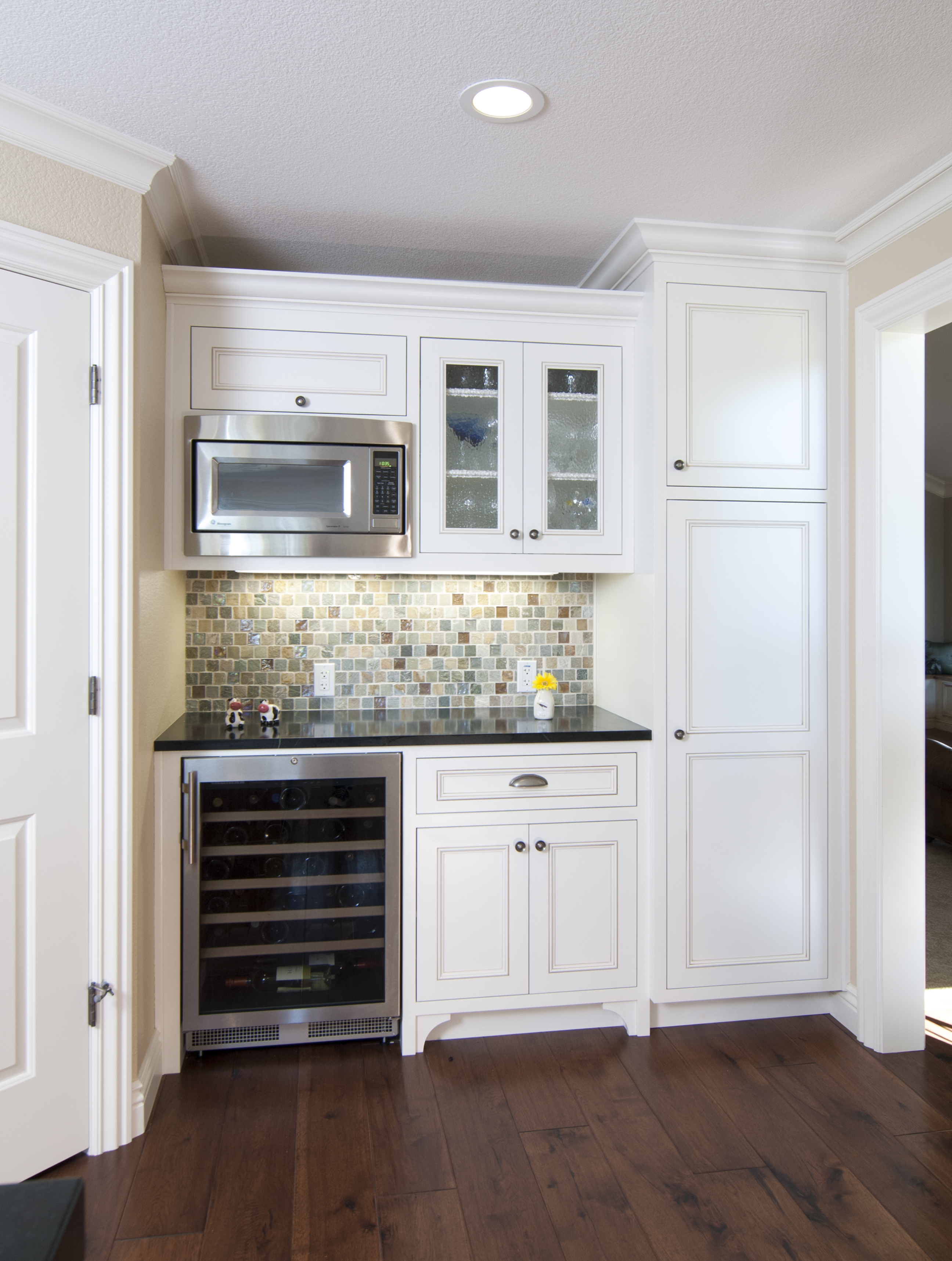 Transitional White Wine Bar with a Built-In Wine Cellar, Decorative Glass Doors and Chrome Hardware