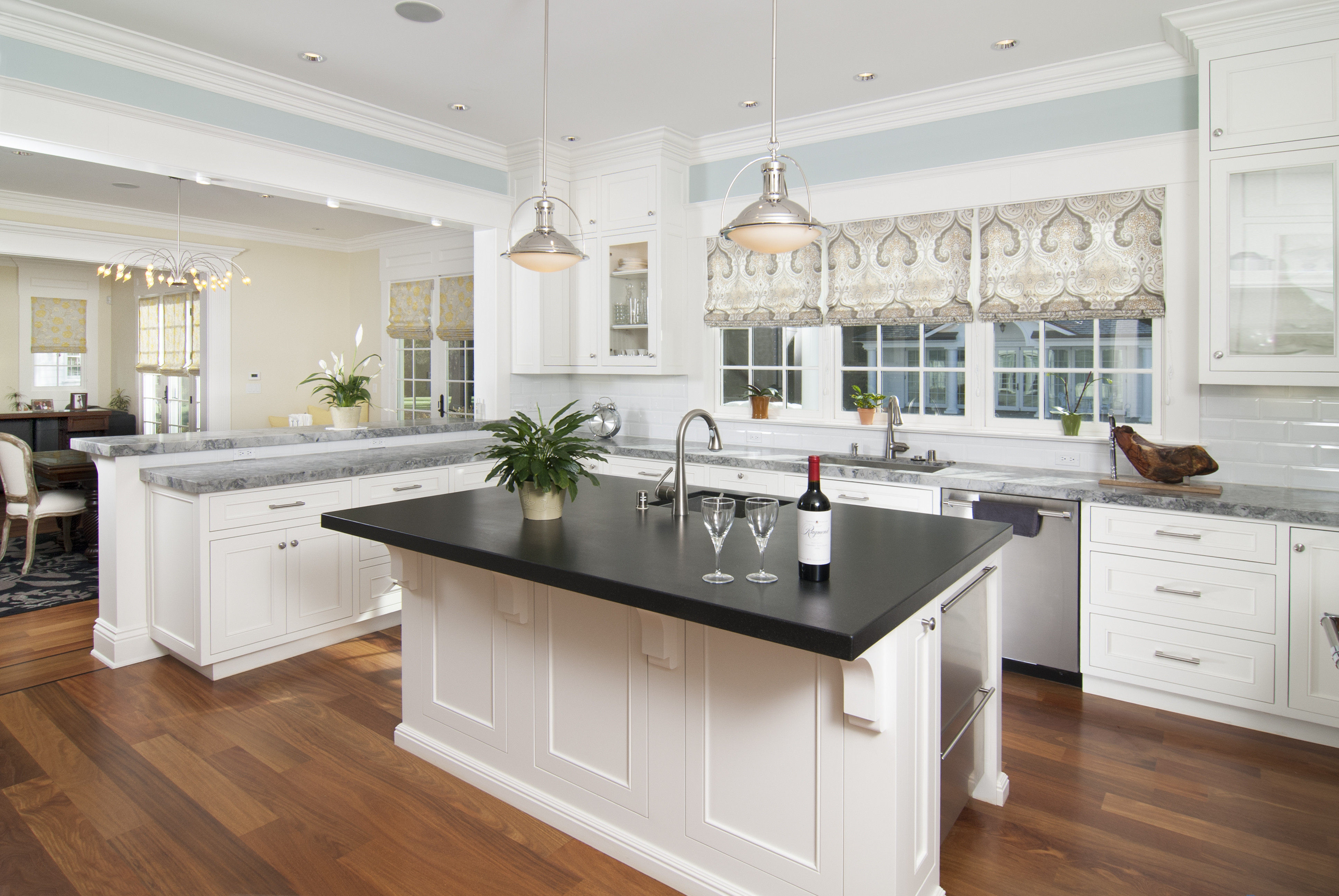 White Transitional Kitchen With A Matching Island, Marble Counter Tops,  Glass Doors, Silver