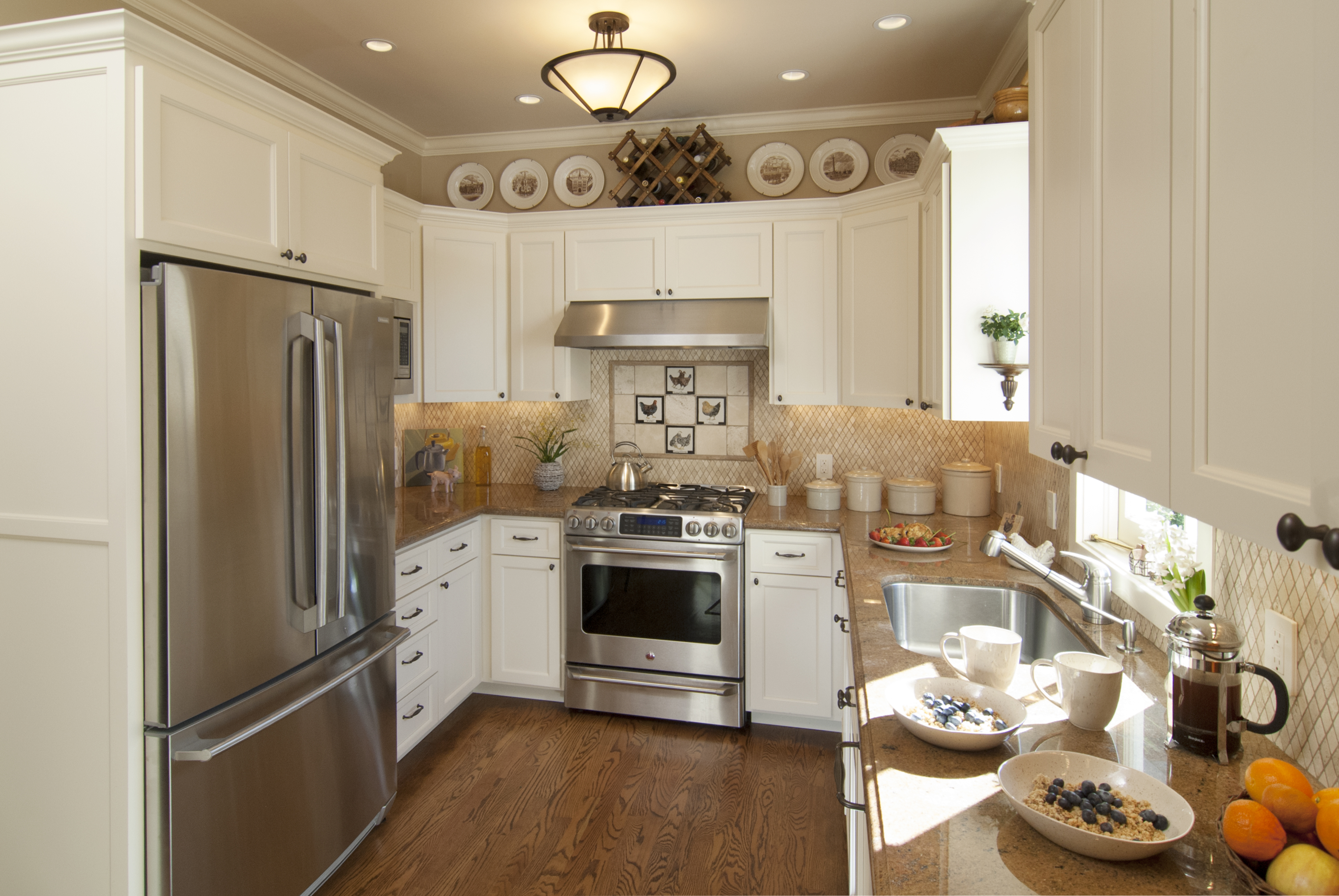 Transitional Off White Kitchen With Stainless Steel Appliances And Oil Rubbed Bronze Hardware