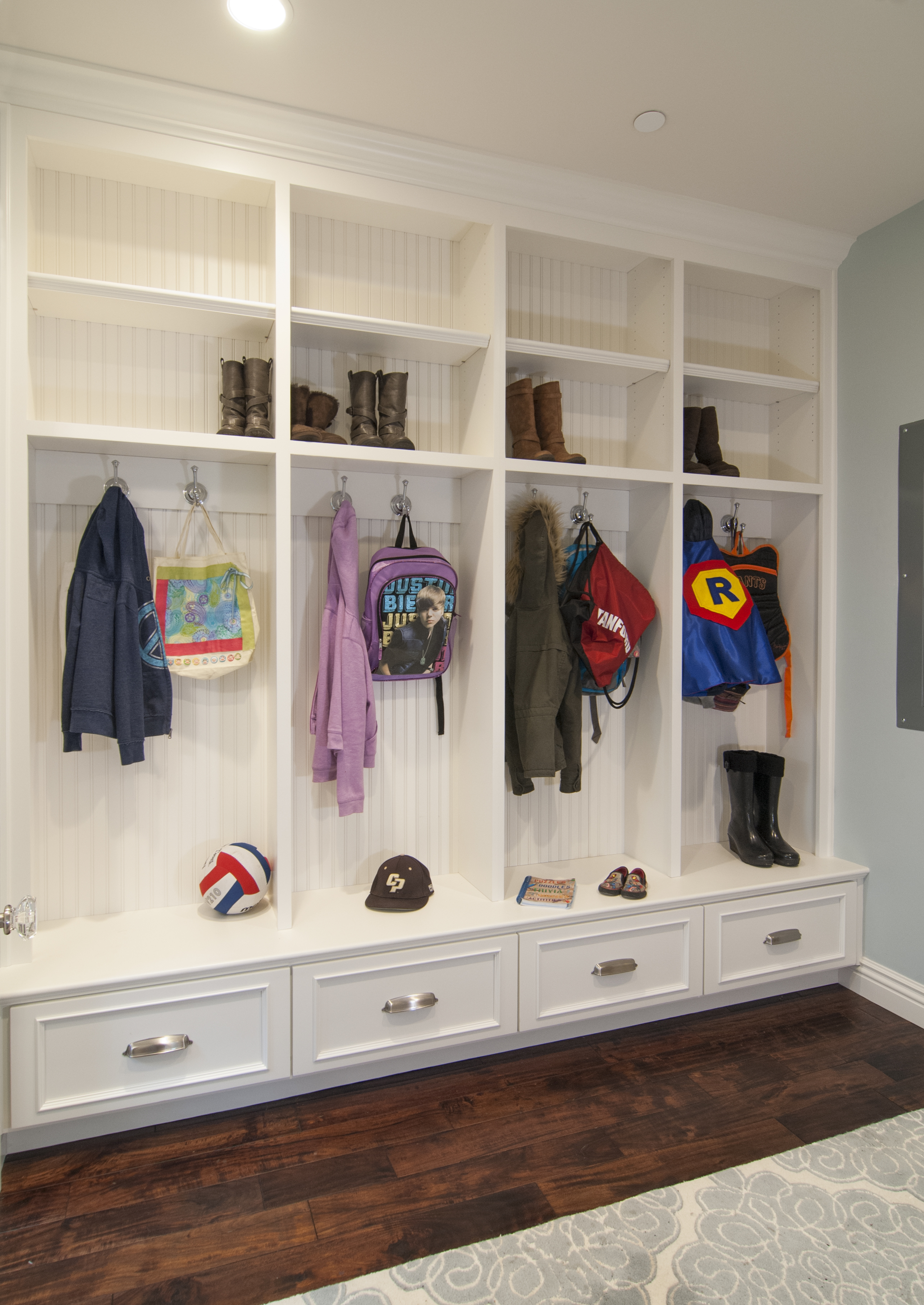 Beautiful White Mudroom Built-In with Beadboard Backing, Open Shelves and Silver Hardware