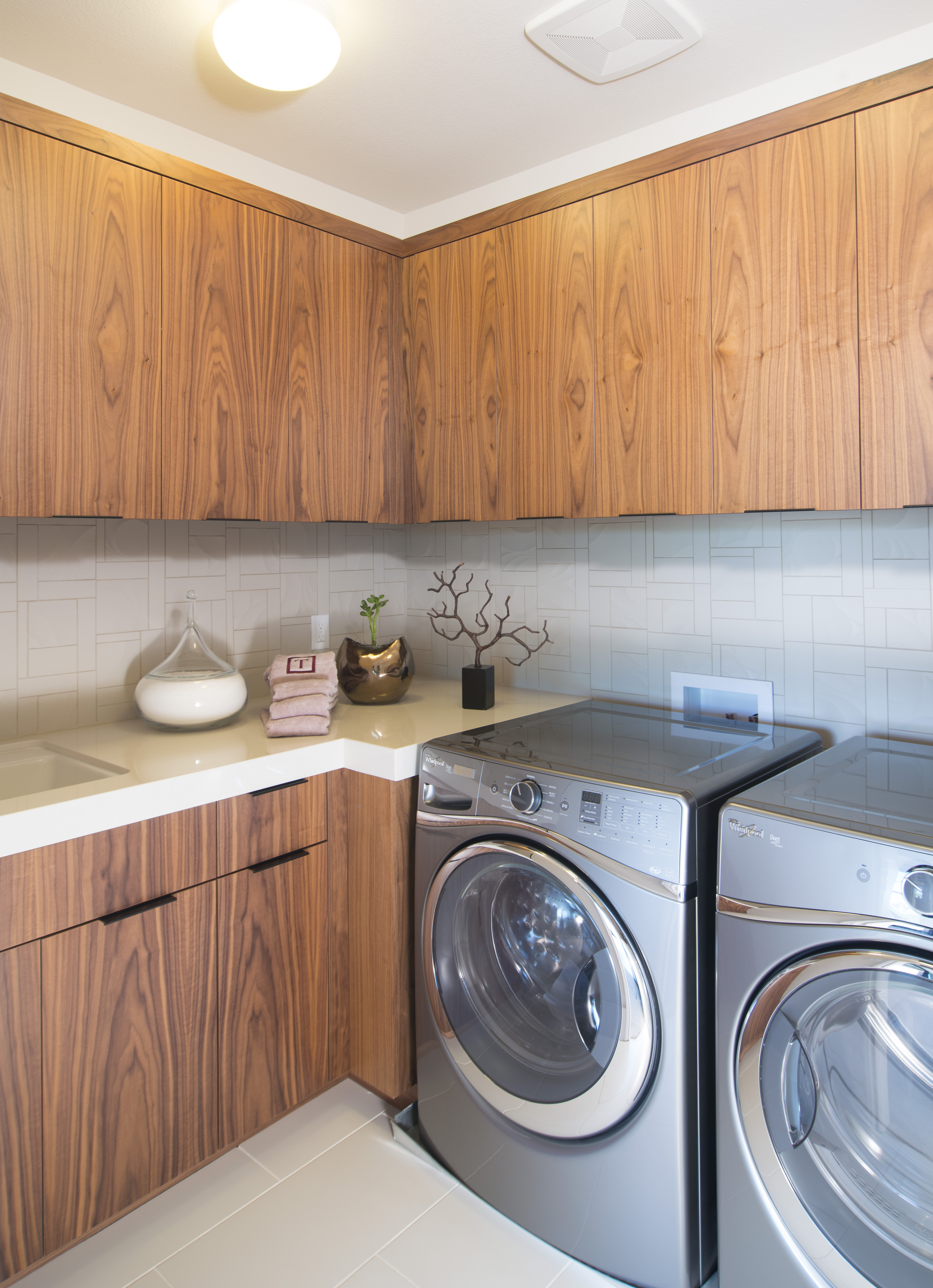 Beautiful Contemporary Laundry Room Built-Ins made out of Walnut and Finished with a Natural Clear Coat