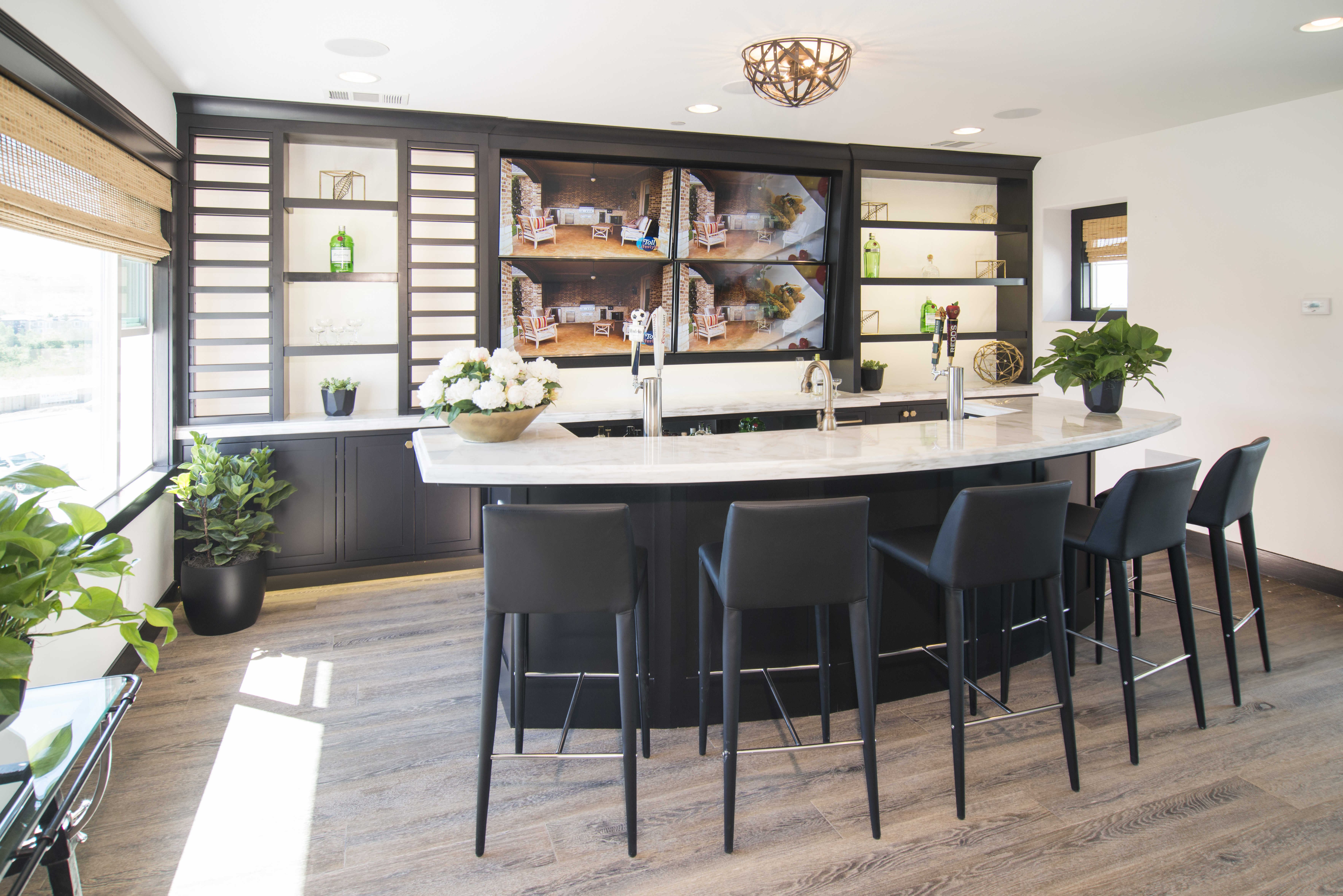 Beautiful Black Bar Room Cabinets With Open Shelves, Back Lighting And  White Mixed Counter Tops