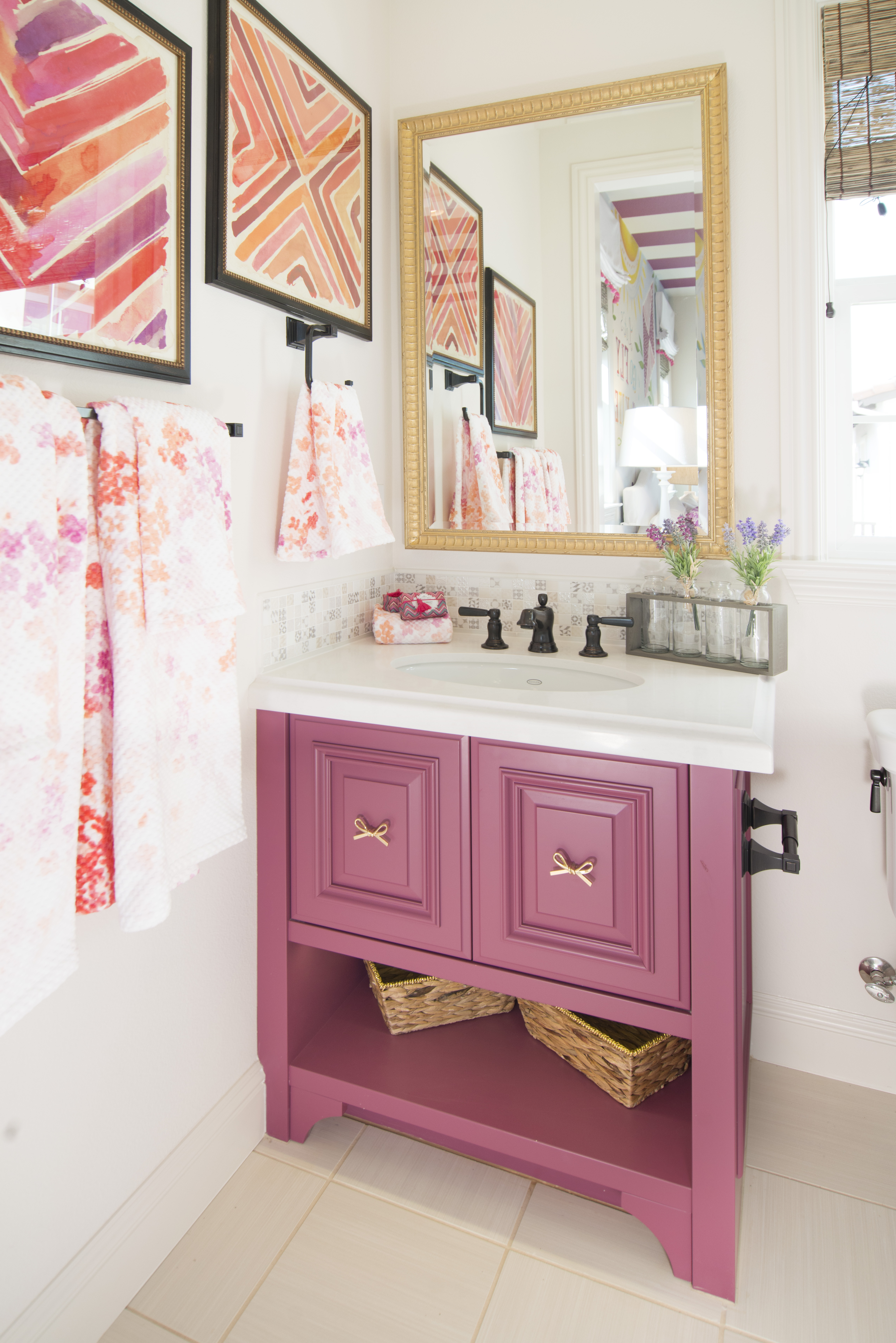 Beautiful Pink Bathroom Vanity With A White Counter Top And Gold Ribbon  Pulls