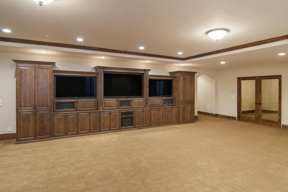Beautiful Entertainment Center Built in Knotty Alder and Finished with a Chocolate Stain with Three Flat Screen TV's, Wire Mesh Doors and Decorative Hardware