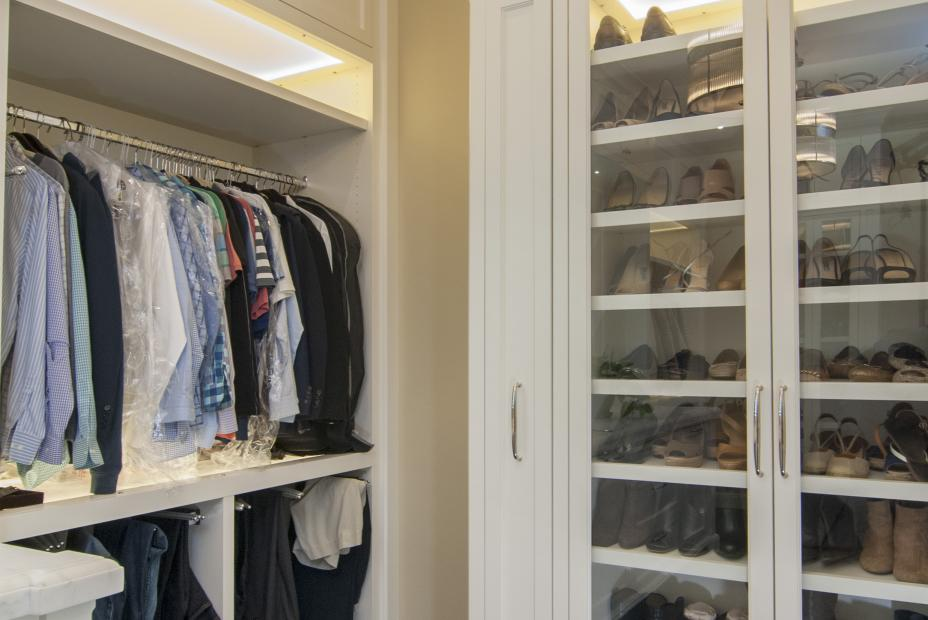 Transitional His and Hers Walk-In Closet with Glass Doors and Stainless Steel Knobs - Pulls