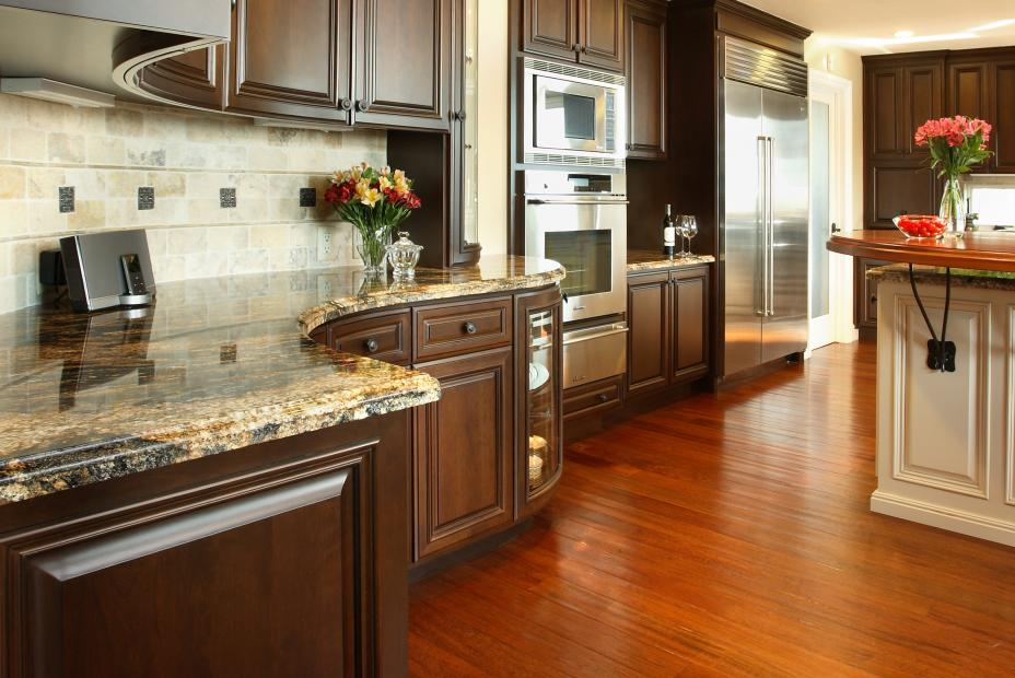 Traditional Stained Kitchen with a Beautiful Off White Island, Granite Countertops and Stainless Steel Appliances