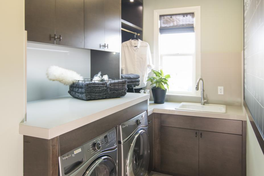 Contemporary Laundry Room with a White Counter Top, Silver Washer - Dryer and Hinged Rail for Clothing