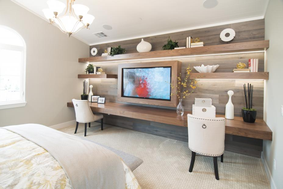 Beautiful Walnut Entertainment Center for a Master Bedroom with Floating Shelves and a TV Frame