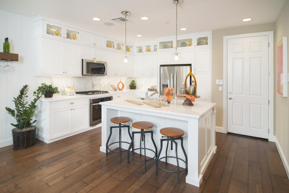 Transitional White Kitchen with Glass Doors, Puck Lights and Stainless Steel Appliances