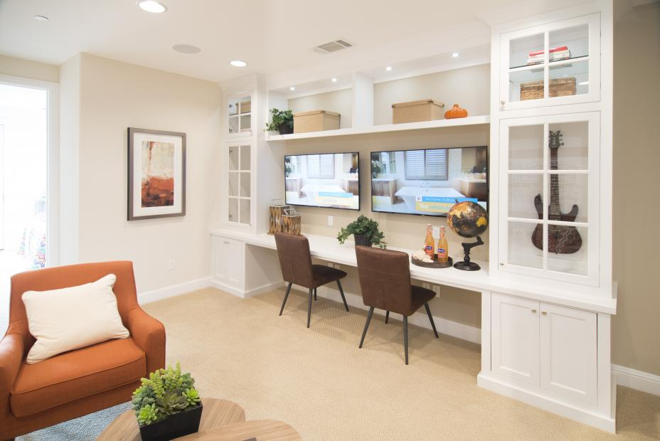 Beautiful White Entertainment Center with Glass Shelves, Glass Doors, Puck Lights and Double Flat Screen TV's
