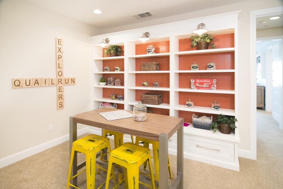 Beautiful Transitional White Game Room Entertainment Center with Orange Beadboard Backing and Silver Pulls