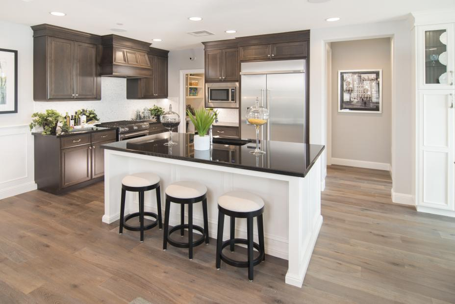 Beautiful Kitchen Built in Maple with a White Island, Dark Counter Tops and Stainless Steel Appliances