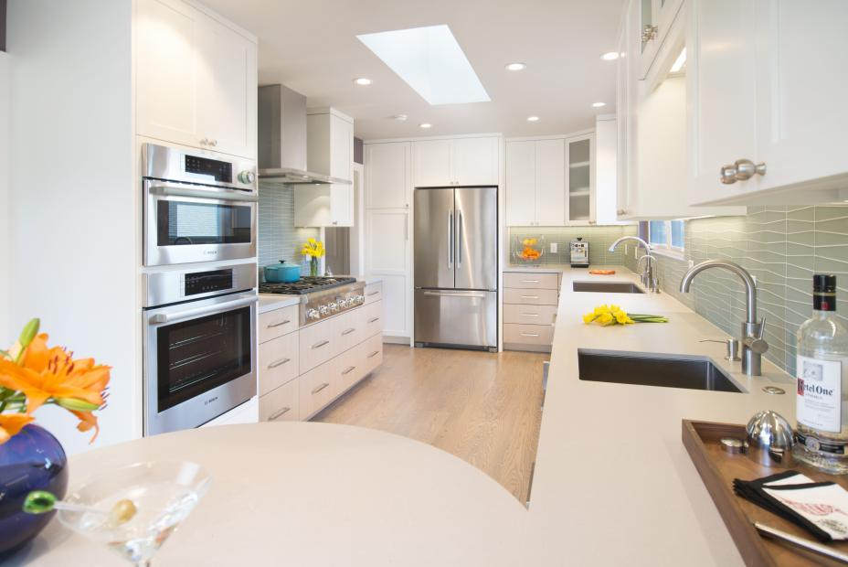 Beautiful Two Toned Contemporary Kitchen with Glass Doors, Stainless Steel Appliances and Silver Knobs - Pulls