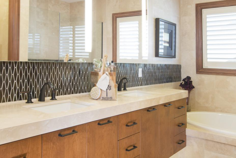 Contemporary Master Bathroom with a Beautiful White Counter Top, Double Sinks and Oil Rubbed Bronze Faucets