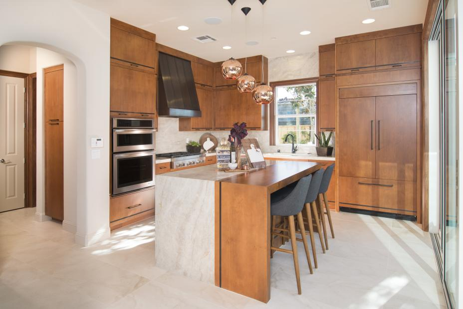 Contemporary Clear Alder Kitchen with a Beautiful Waterfall Island, Wood Hood and Stainless Steel Appliances