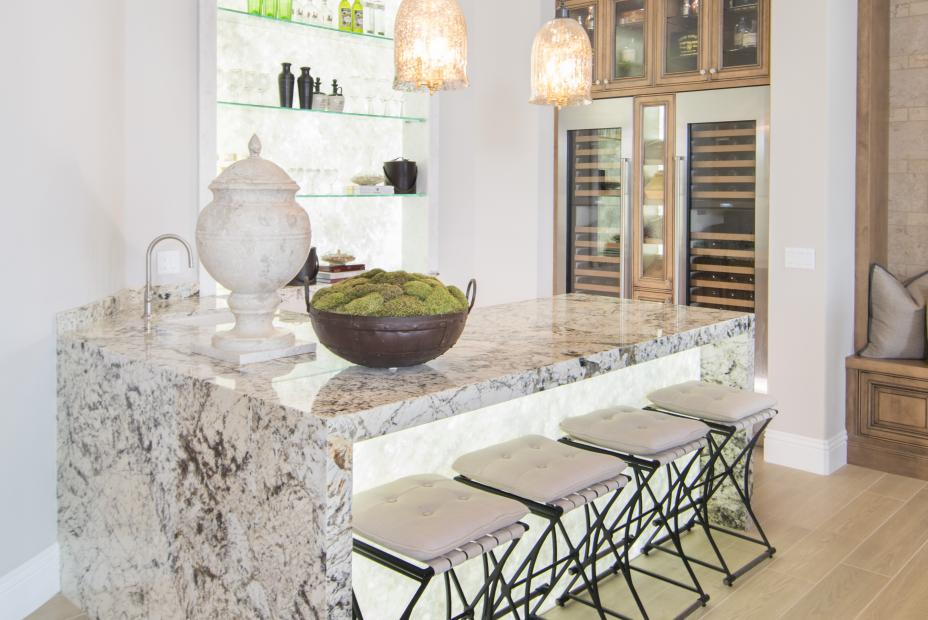 Wine Bar with a Beautiful Waterfall Marble Island and Glass Shelves
