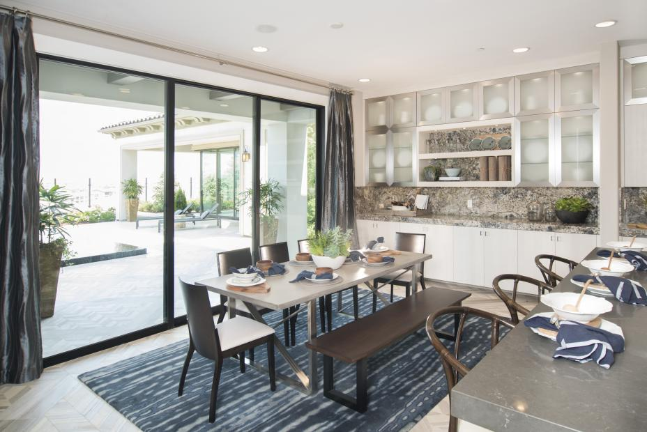Contemporary White Kitchen Built in Textured Linen Material with Beautiful Aluminum Door Frames and Granite Counter Tops