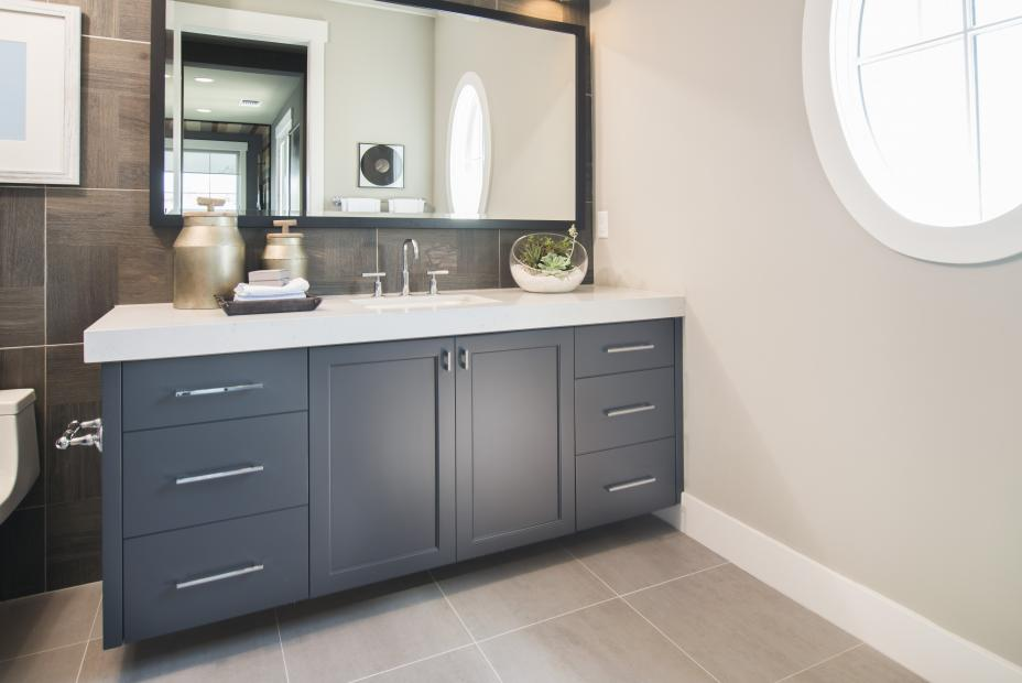 Beautiful Painted Bathroom Vanity with a White Counter Top, Silver Pulls and Faucet