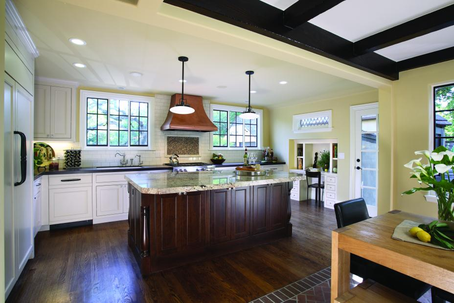 Transitional White Kitchen with a Chocolate Stained Island, Granite Countertops and Built-In Refrigerator