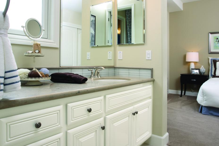 Traditional White Bathroom Vanity with a Marble Countertop and Decorative Knobs