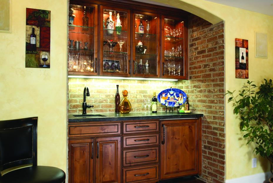 Beautiful Traditional Bar with Decorative Doors, Black Mixed Counter Top and an Oil Rubbed Bronze Faucet