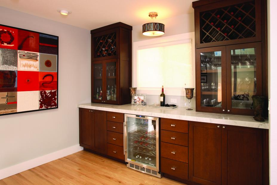 Beautiful Stained Wine Bar with Glass Doors, Vertical Wine Storage, a Wine Cellar and Marble Counter Tops