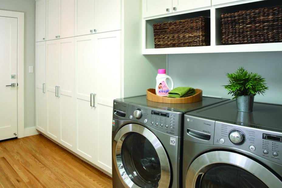 White Transition, Shaker Style Laundry Room Cabinets with Two Open Cubbies and a Beautiful Grey LG Washer - Dryer