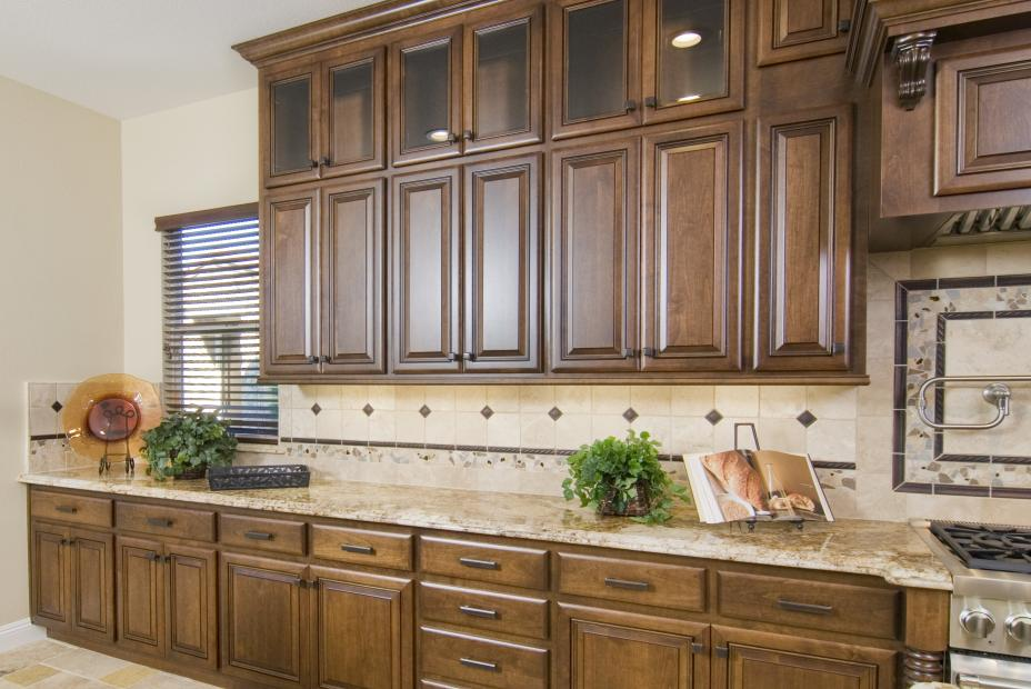 Traditional Stained Kitchen with Glass Doors, Granite Counter Tops and Oil Rubbed Bronze Hardware