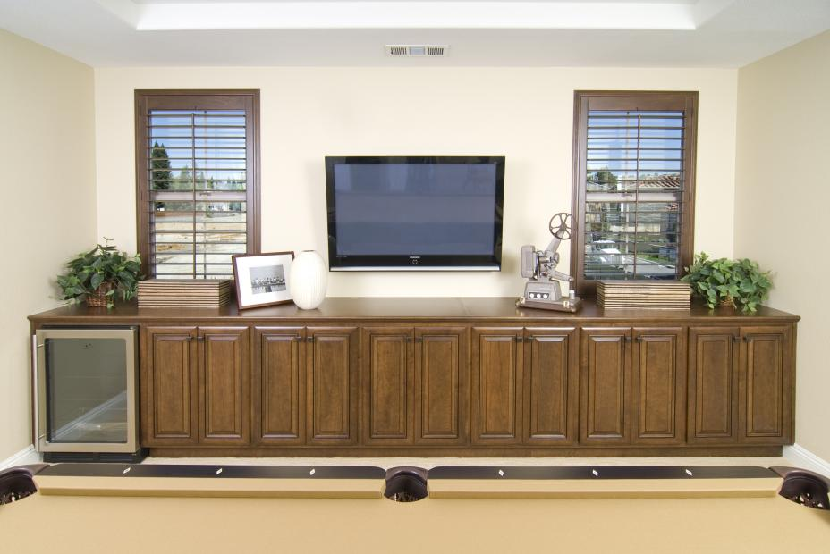 Traditional Entertainment Center for a Game Room with a Built-In Wine Cellar and Oil Rubbed Bronze Knobs