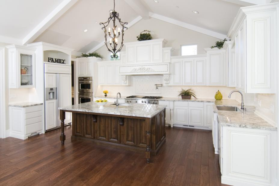 Traditional White Kitchen with a Chocolate Stained Island, Beautiful Granite Countertops and Stainless Steel Appliances