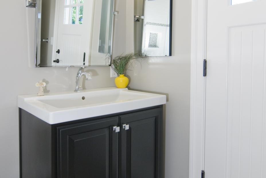 Traditional Bathroom Vanity Stained in Dark Espresso with a White Countertop and Chrome Hardware