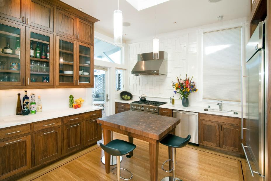Transitional Walnut Kitchen with White Countertops and Stainless Steel Appliances