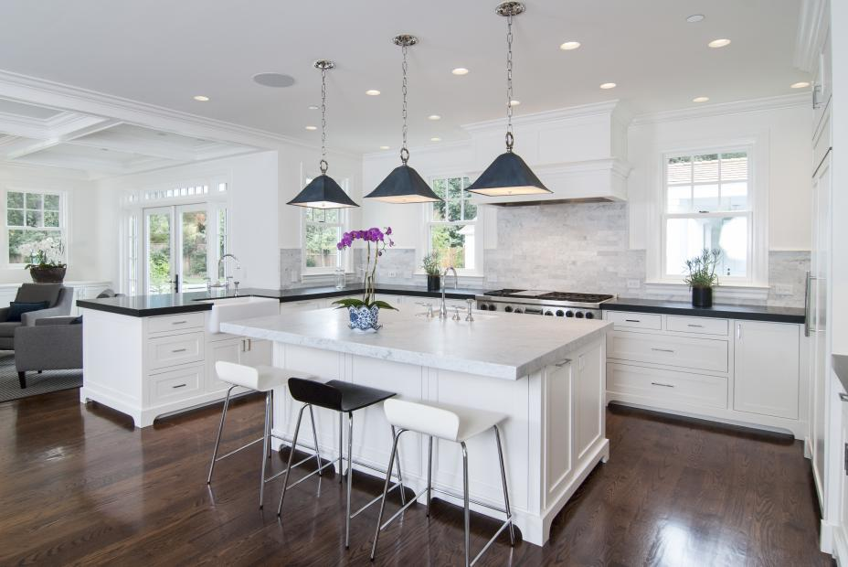 White Transitional, Shaker Style Kitchen with a Built-In Refrigerator and Stainless Steel Appliances