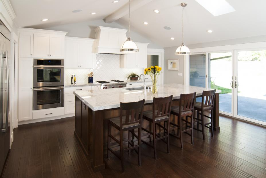White Transitional, Shaker Style Kitchen with a Beautiful Chocolate Stained Island, Marble Countertops and Stainless Steel Appliances