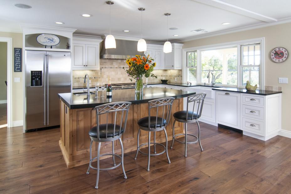 Transitional White Kitchen with a Beautiful Stained Island built in Knotty Alder