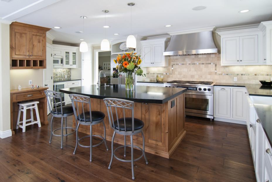 Transitional White Kitchen with a Beautiful Stained Island built in Knotty Alder and Black Countertops