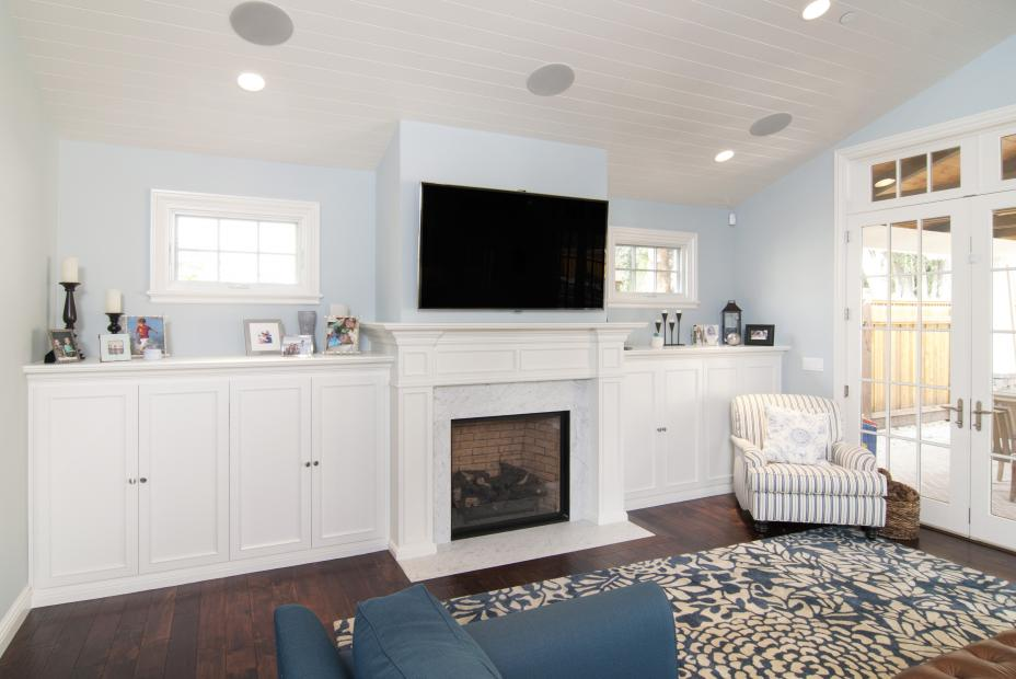 White Transitional Entertainment Center with a Fire Place Mantel and Silver Pulls