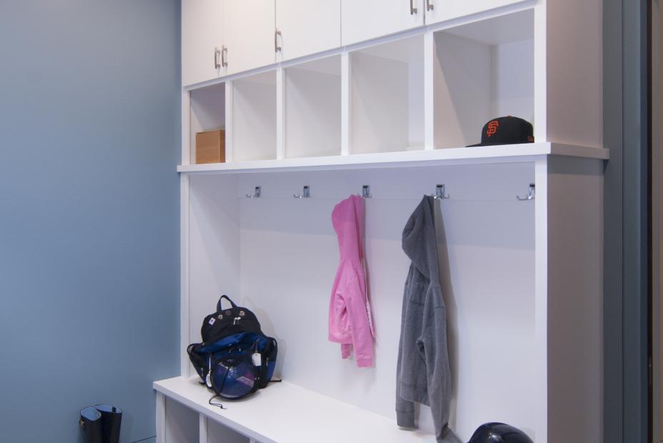 Contemporary White Mudroom Built-In with Open Cubbies and Silver Hardware