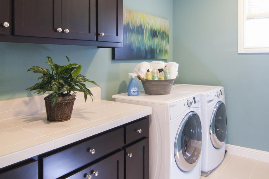 Transitional, Shaker Style Laundry Room Finished in a Dark Espresso Stain with a Whirlpool Washer and Dryer