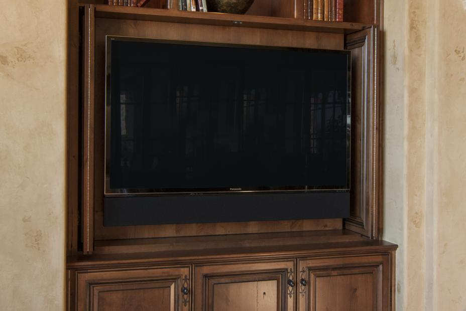 Rustic Entertainment Center Built in Knotty Alder with Open Shelves and Puck Lighting