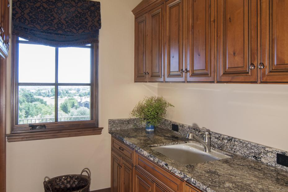 Beautiful Rustic Knotty Alder Laundry Room with a Beautiful Granite Counter Top